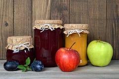 Jam jars and fresh fruits Stock Photos