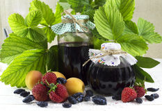 Jam jars with ingredients Stock Photo