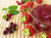 Jam with juneberries and strawberries Royalty Free Stock Photography