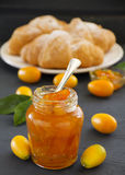Jam of kumquats with croissant. Royalty Free Stock Images
