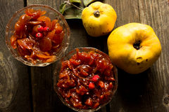 Jam made from apples and quince on straw background Stock Image