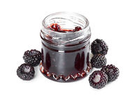 Jam made from black raspberries Cumberland in glass jar. On white background Royalty Free Stock Images