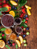 Jam made from different berries in glass jars Stock Image