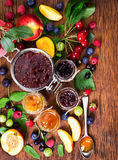 Jam made from different berries in glass jars Royalty Free Stock Photo
