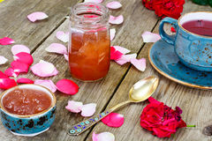 Jam Made of Rose Petals on the Old Wooden Boatds Stock Images
