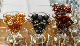 Jam nut, white cherry and paradise apples and glass for tea Royalty Free Stock Photography