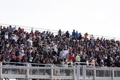 Jam-packed Grandstand Bahrain Airshow 2012. Sakhir Airbase, Bahrain - JANUARY 21: Jam-packed Grandstand with spectators to view the flying display and aerobatic stock photos