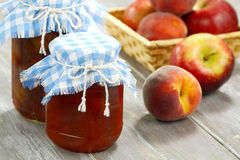 Jam, peaches and apples Stock Images