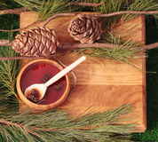 Jam of pine cones on a wooden texture with pine cones Stock Photos