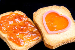 Jam, plastic heart and bread Royalty Free Stock Photography