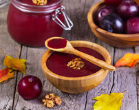 Jam with plums and walnuts Stock Photo