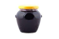 Jam pot. Of black currant isolated on white background royalty free stock photo