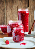 Jam from Raspberries in a Jars on the wooden background Stock Photos