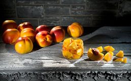 Jam from the ripe peaches and fresh peaches Stock Photo