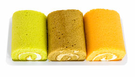 Jam roll cakes. In plate on white background Stock Photos