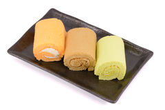 Roll cakes. Isolated on white background Stock Images