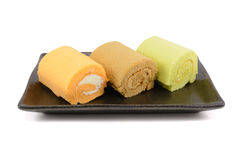Roll cakes. Isolated on white background Royalty Free Stock Images
