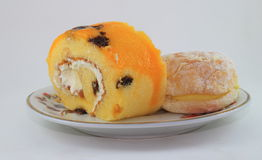 Jam roll and donut on the dish Stock Image