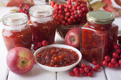 Jam of rowan  and apples. Jam of rowan and apples in glass and fruits and berries on the table Royalty Free Stock Photo