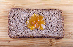 Jam on rye bread Royalty Free Stock Image