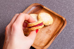 Jam sandwich cookies powdered with cocos Royalty Free Stock Images