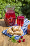 Jam shortbread cookies and red compote with cherries, strawberries, gooseberries, raspberries and apricot jam Stock Photography