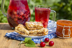 Jam shortbread cookies and red compote with cherries, strawberries, gooseberries, raspberries and apricot jam Royalty Free Stock Photography