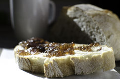 Jam spread on fresh bread. Homemade Jam spread onto fresh baked bread Stock Photo