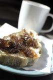 Jam spread on fresh bread. Homemade Jam spread onto fresh baked bread Stock Images