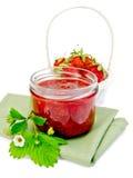 Jam strawberry with basket of berry on napkin Stock Image