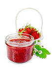 Jam strawberry with strawberries in a basket Royalty Free Stock Images