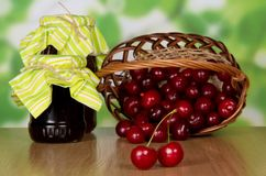 Jam, sweet cherries which dropped out of a basket Royalty Free Stock Photography