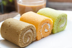 Jam swiss roll cake three flavors. Stock Image