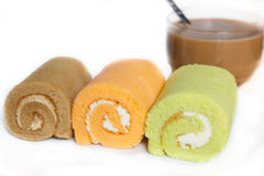 Jam swiss roll cake three flavors. Stock Photos