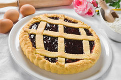 Jam tart in white dish. Stock Image