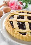 Jam tart in white dish. Stock Photography
