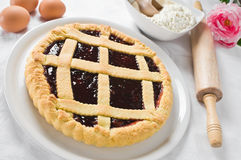 Jam tart in white dish. Stock Photo
