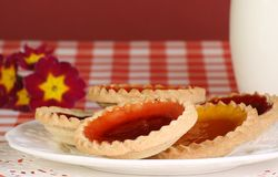 Jam tarts. Delicious jam tarts on a plate with milk Royalty Free Stock Photo