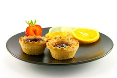 Jam Tarts on a Black Plate Stock Photography