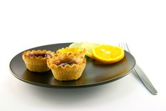 Jam Tarts with Citrus Slices and Fork Royalty Free Stock Image