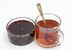Jam and tea cup Stock Photos