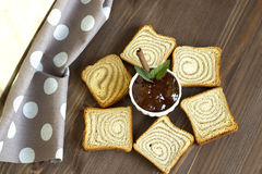 - jam and toast on a wooden board. Apple jam with cinnamon and toast on a wooden stand Royalty Free Stock Image
