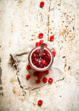 Jam from wild raspberries in the jar. On rustic background Royalty Free Stock Photo