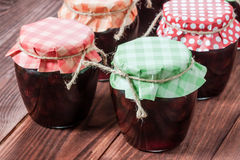 Jam on wooden background. Royalty Free Stock Photos