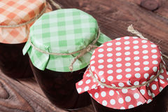 Jam on wooden background. Royalty Free Stock Photography