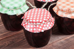 Jam on wooden background. Stock Photography
