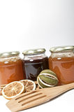 Jam and a wooden spoon Stock Images
