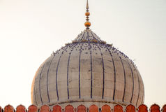 Jama Masjid, The Great Mosque, Old Delhi, India. Detail of the mosque's white marble dome at dusk covered by a flock of birds Stock Images