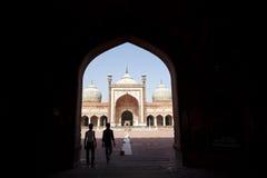 Jama Masjid Mosque. Visitors walking through arch, Delhi, Punjab, India Stock Photography