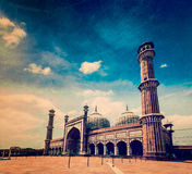 Jama Masjid mosque. Delhi, India. Vintage retro hipster style travel image of Jama Masjid - largest muslim mosque in India with grunge texture overlaid. Delhi Stock Photo